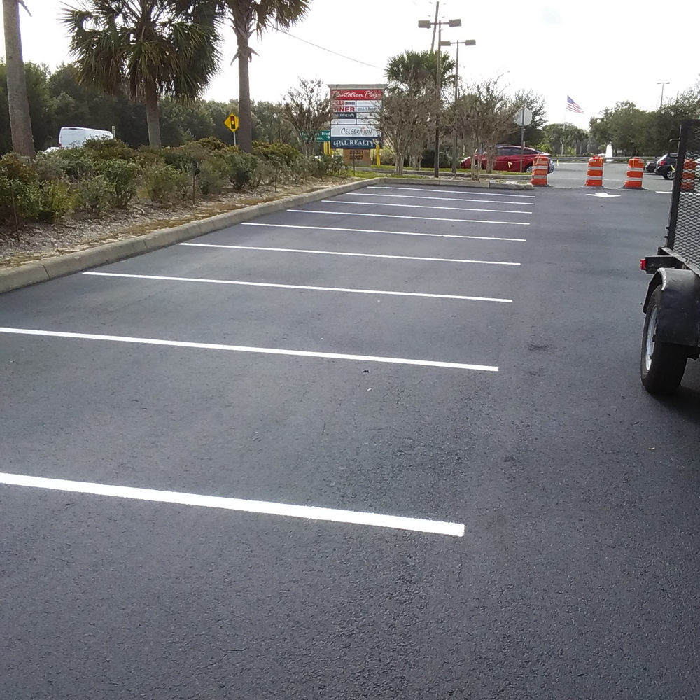 Cigar Lounge Plaza Leesburg Sealcoat & Line Striping Project 3